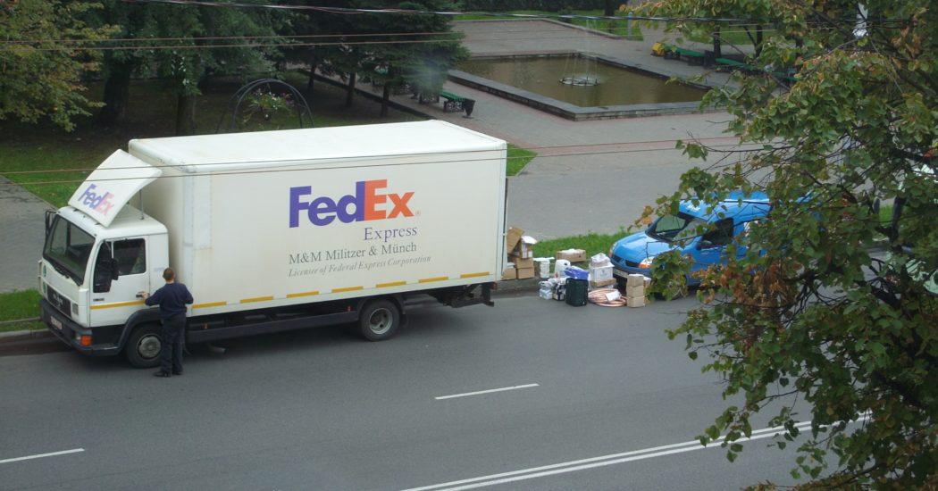a driver ride a Fedex truck