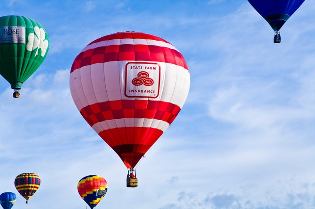 a hot air balloon bearing the old logo of state farm insurance company